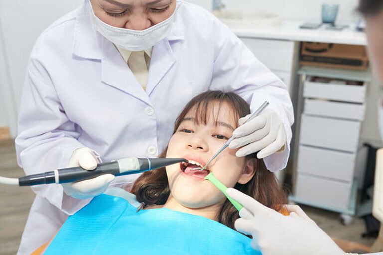 professional-dentists-working-with-teenage-girl-in-DH4QJM8-768x513