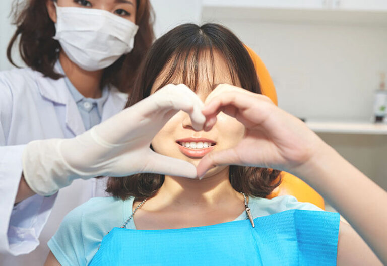 young-woman-with-doctor-making-heart-symbol-6VMJNCS-768x528